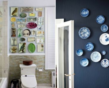Collage of art pieces above toilet and wall of decorative blue plates