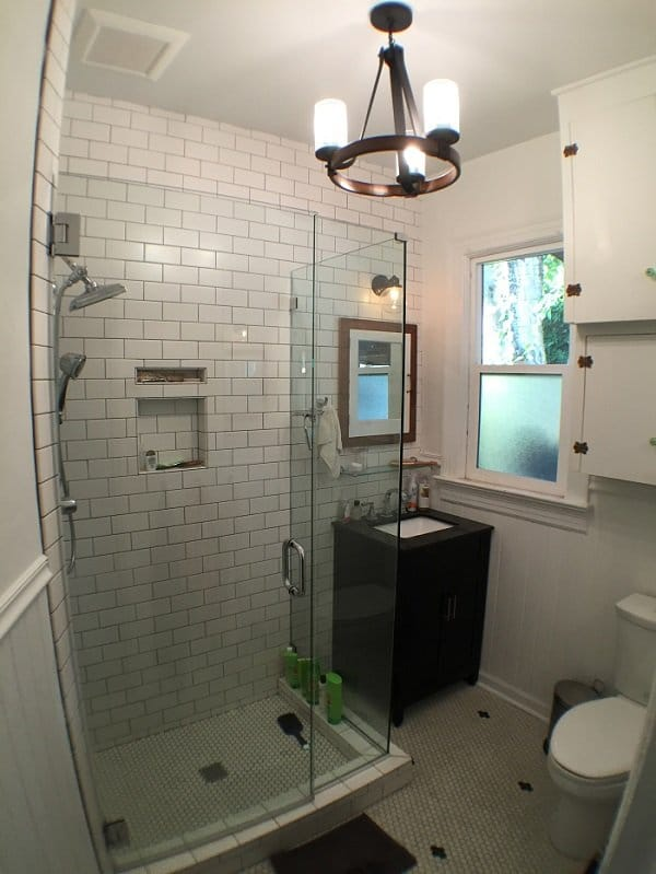All-white bathroom with a white marble bricked shower