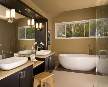 bathroom remodel with vessel sinks and freestanding bath tub