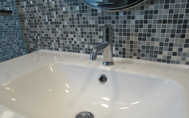 A bathroom faucet with a single hole, single handle faucet