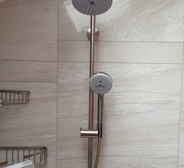 Hansgrohe shower head in tile shower