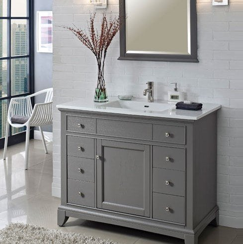 Grey cabinet set against a white wall
