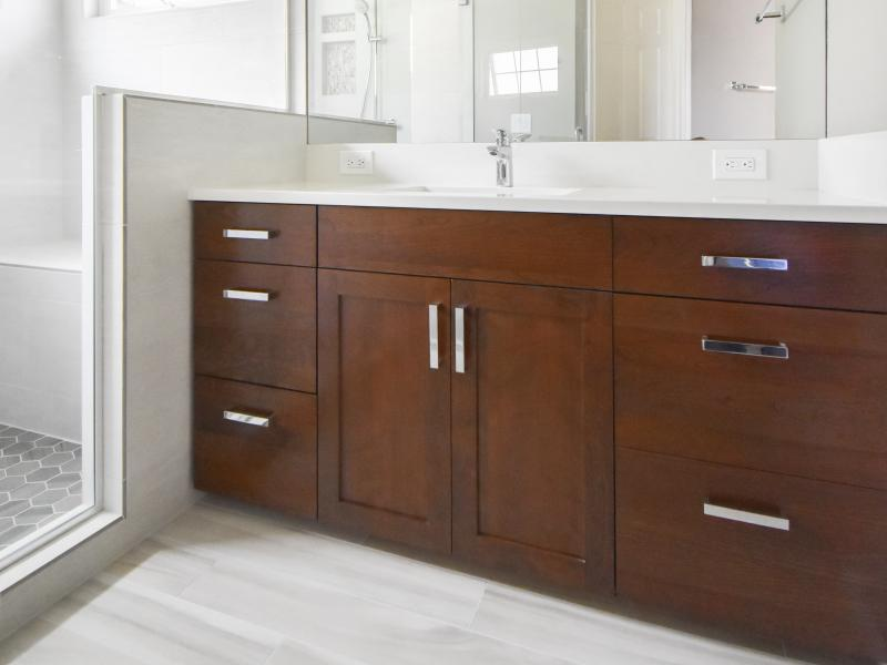 Dark wood vanity with white quartz countertop