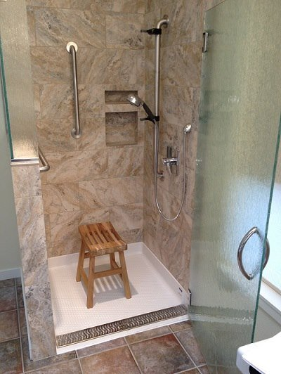 Tile shower with grab bars and shower seat
