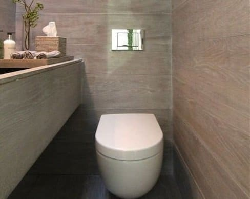 Wall mounted toilet in new bathroom