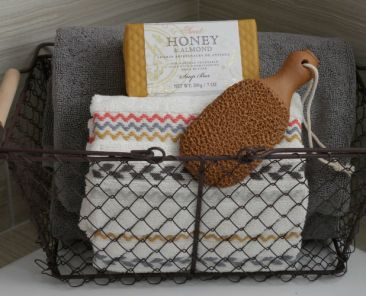 Basket with towels, soap, and scrubber