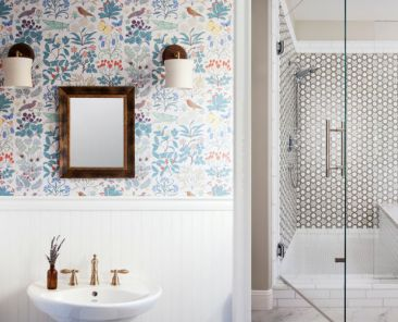 Remodeled bathroom with wallpaper and decorative tile